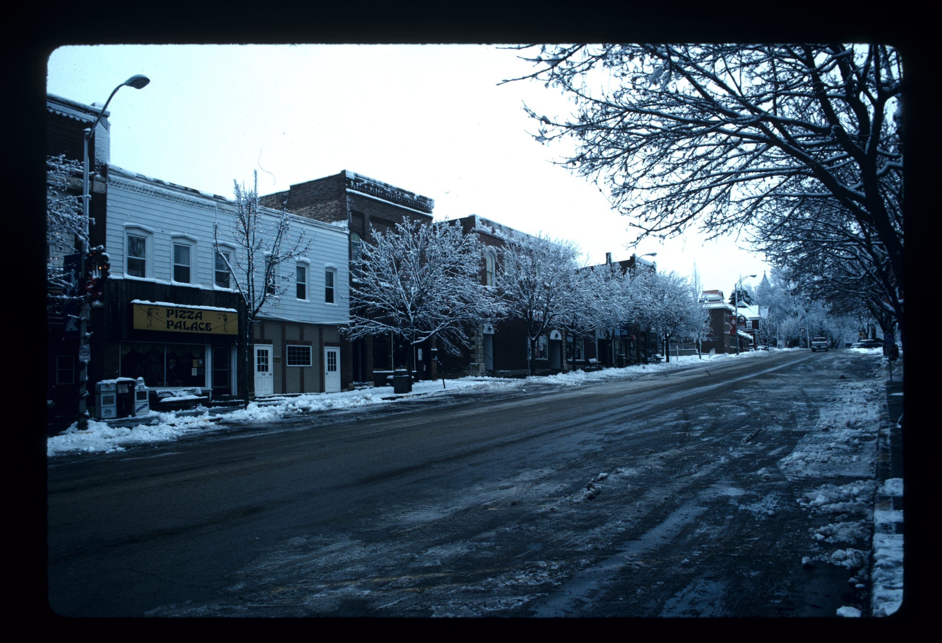 photo of 100 block of 1st Street (Southside) before the fire in Pizza Palace that burned two stores.