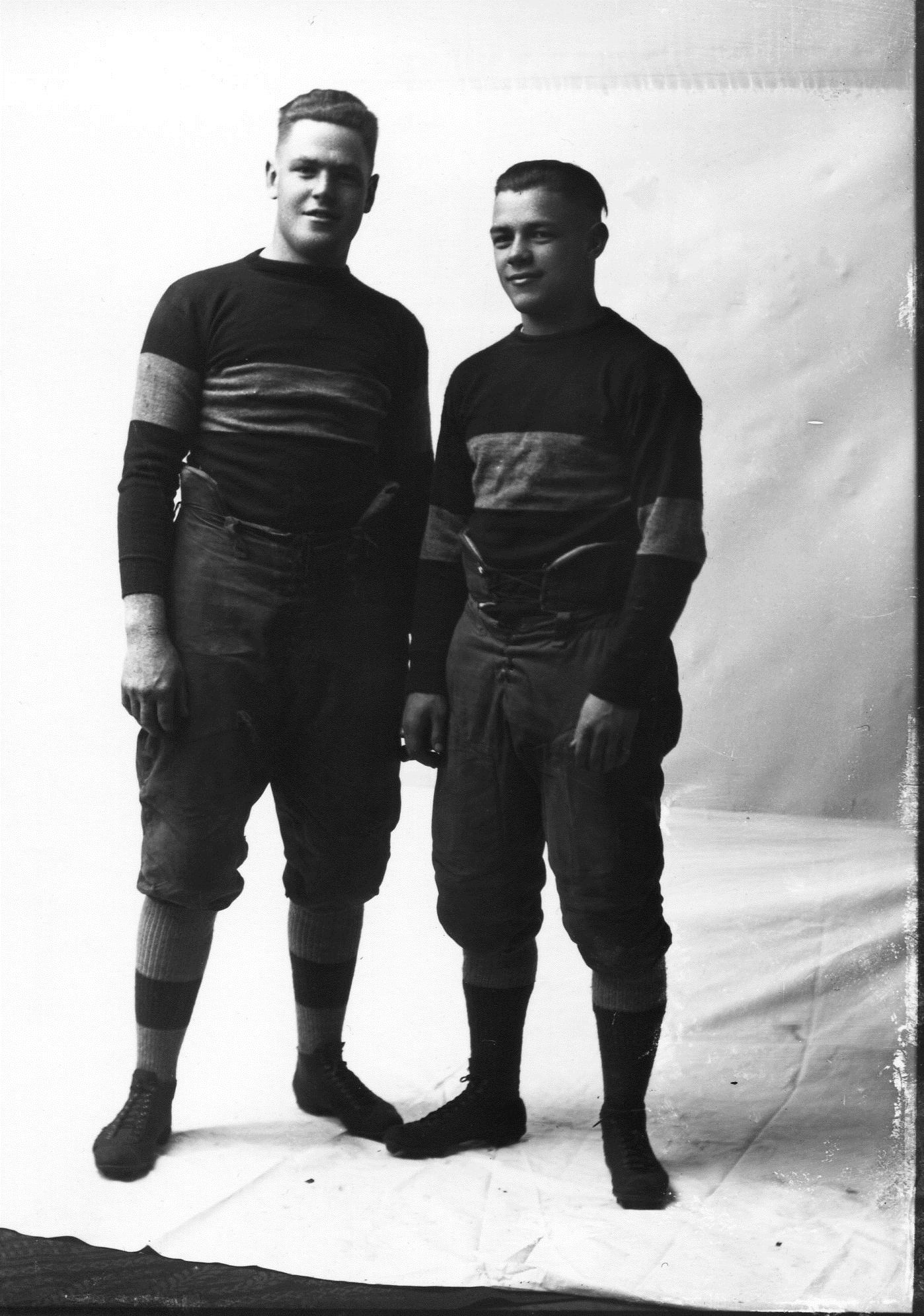 photo of Two Unidentified Cornell Students in Football Uniforms