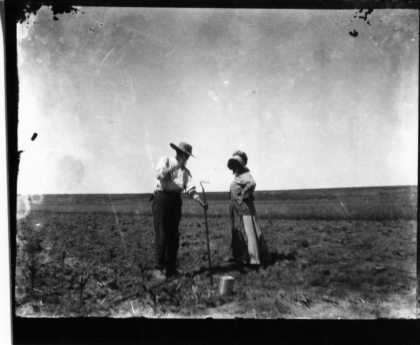 photo of Unidentified Man and Woman in Crop Field