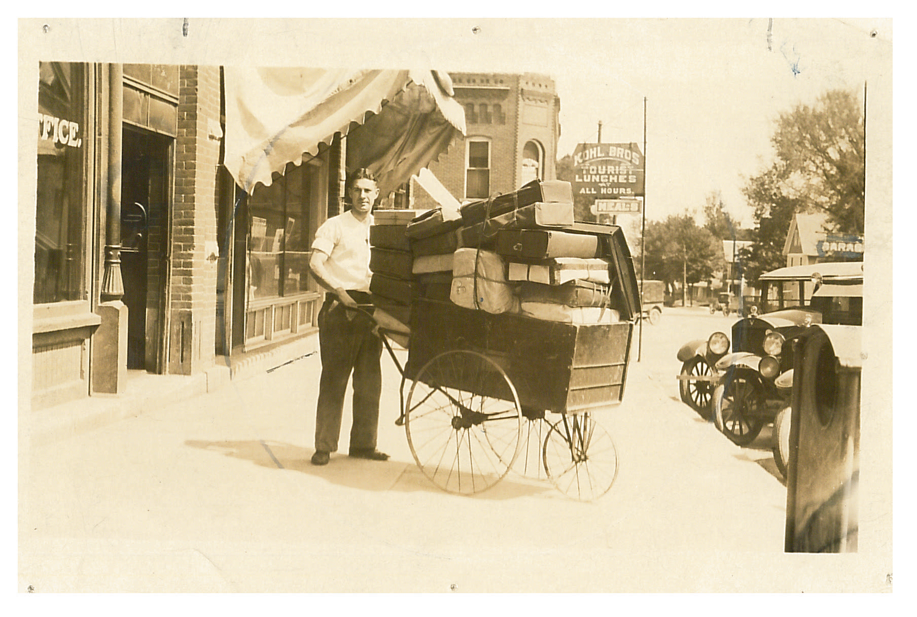 photo of Unidentified Man with Cart of Packages