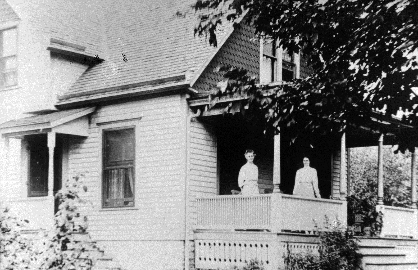 photo of Women Outside of House
