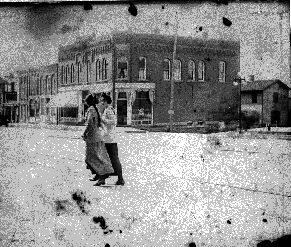 photo of Women Walking Downtown
