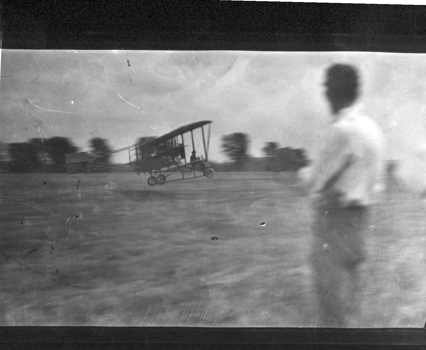 photo of Plane Taking Off From a Field