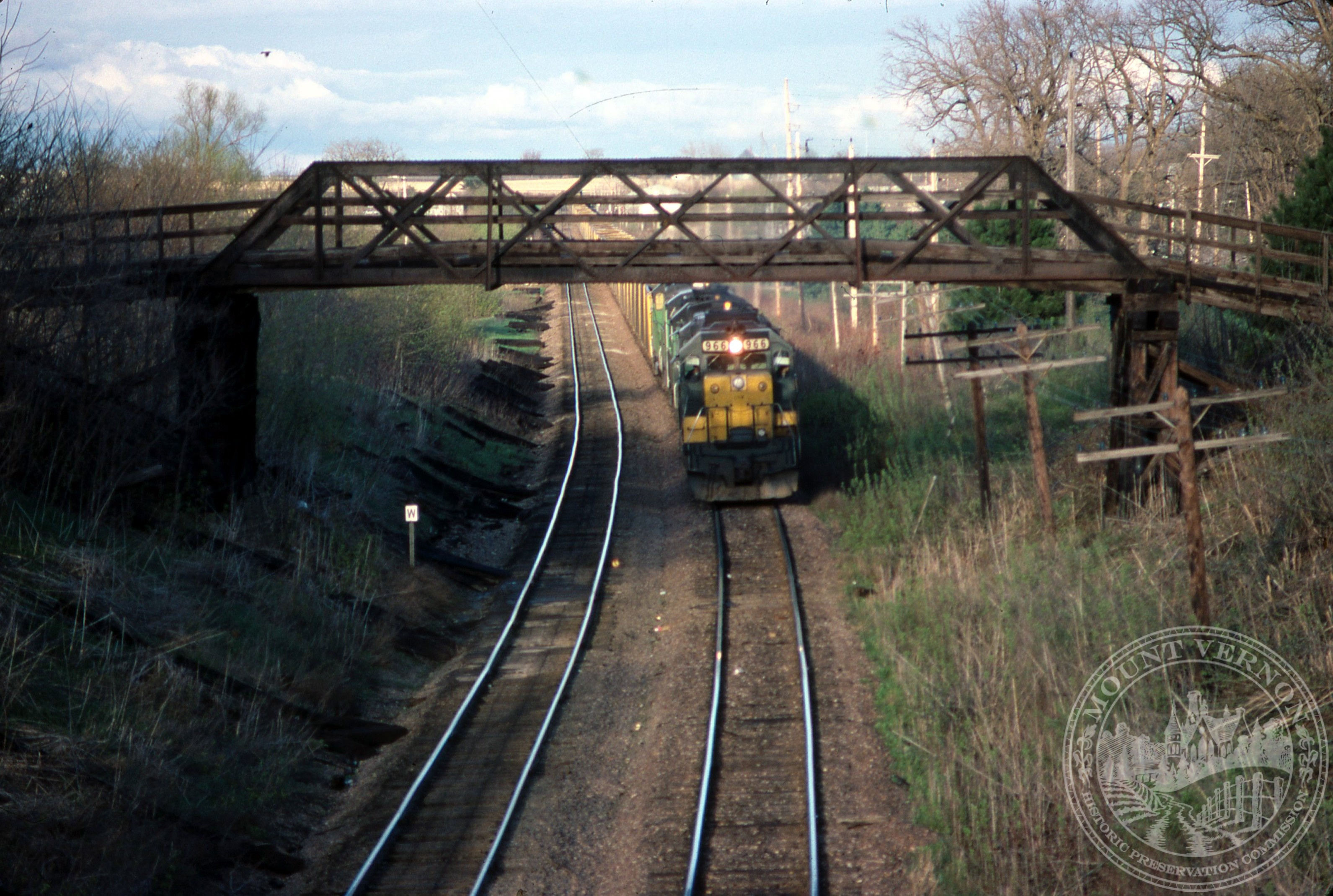 Photo of train under Old Lincoln Highway Bridge