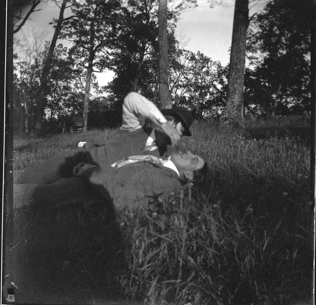 photo of Two Unidentified Men at a Picnic