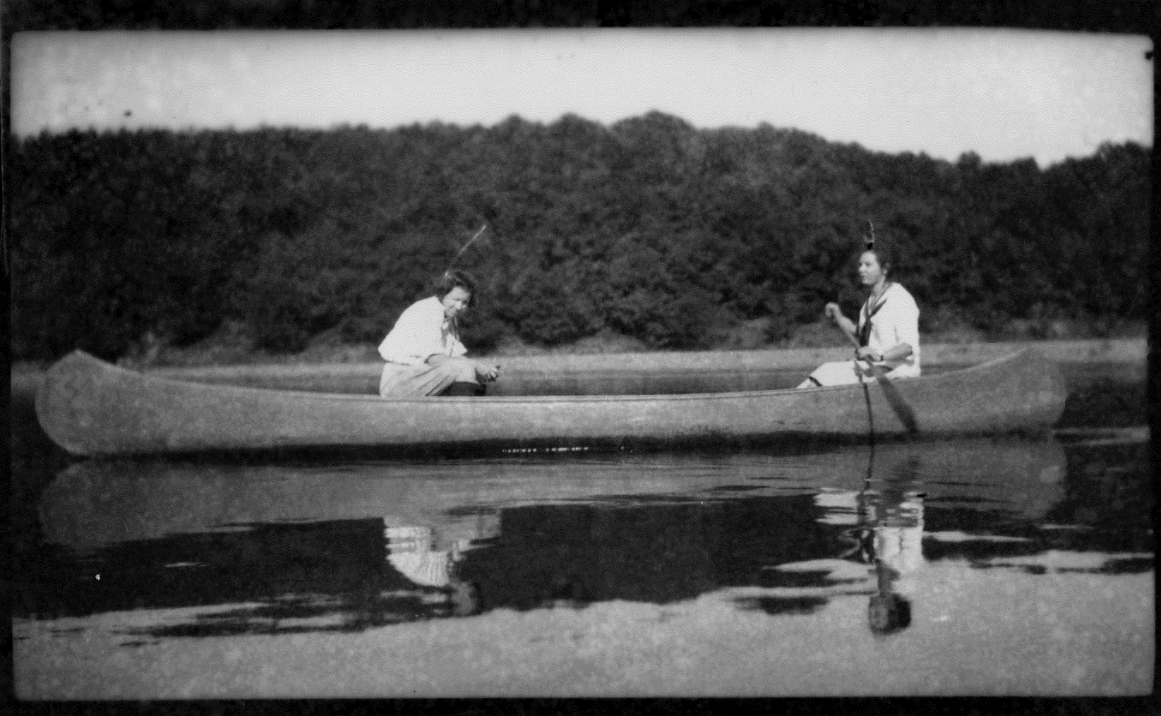 photo of Two Unidentified Women in a Rowboat