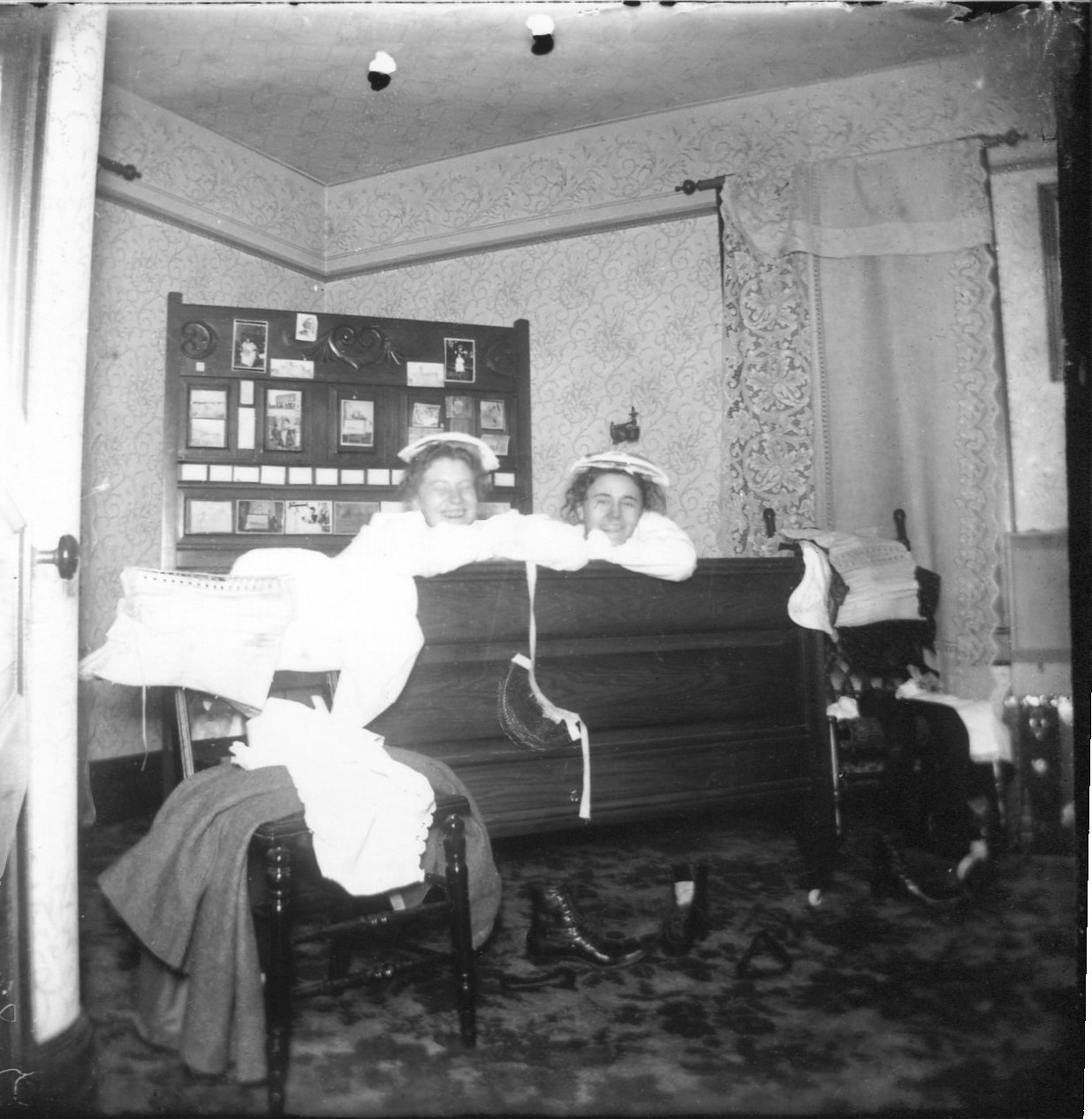 photo of Two Unidentified Women on a Bed