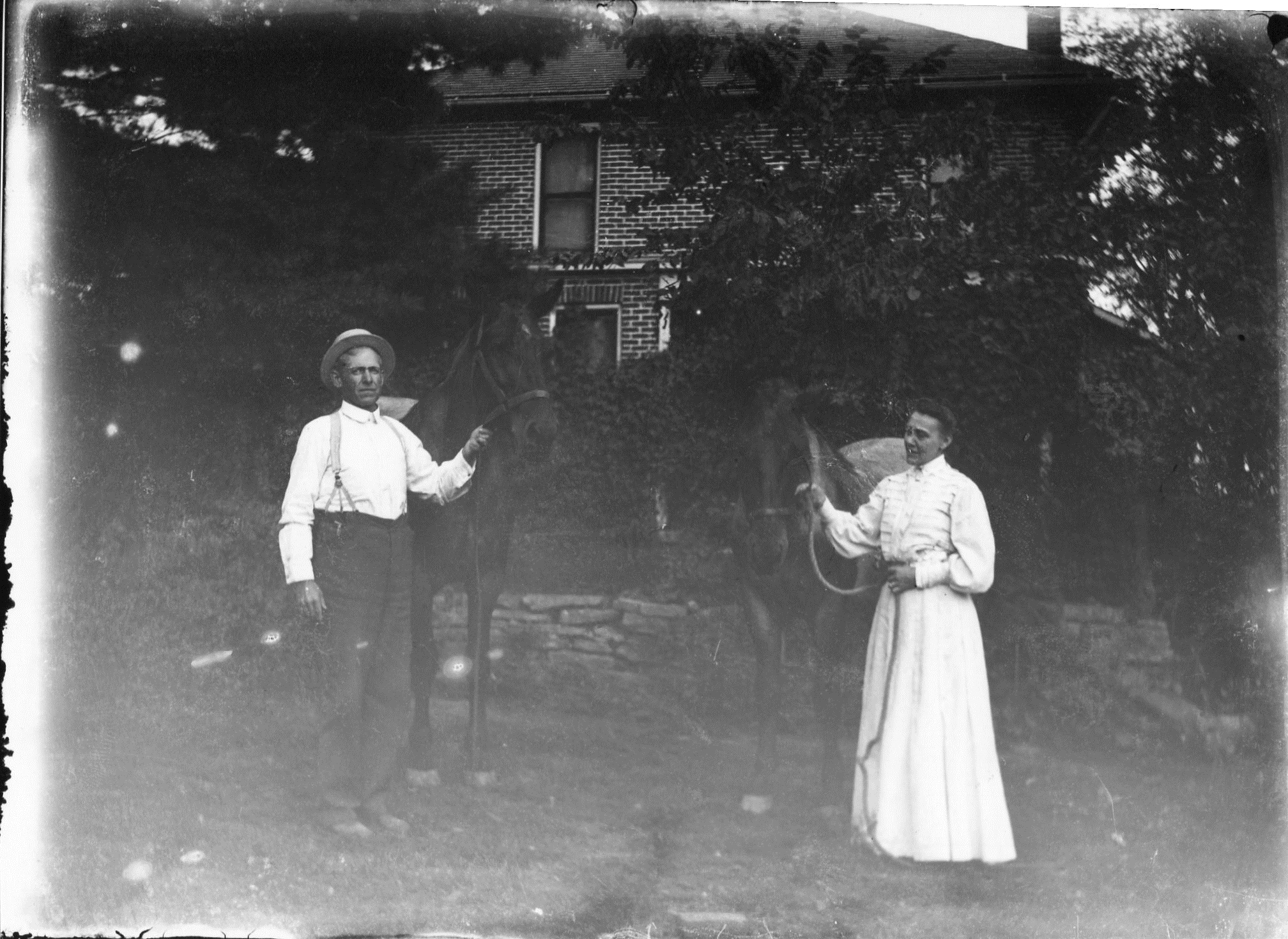 photo of Unidentified Couple Riding Horses