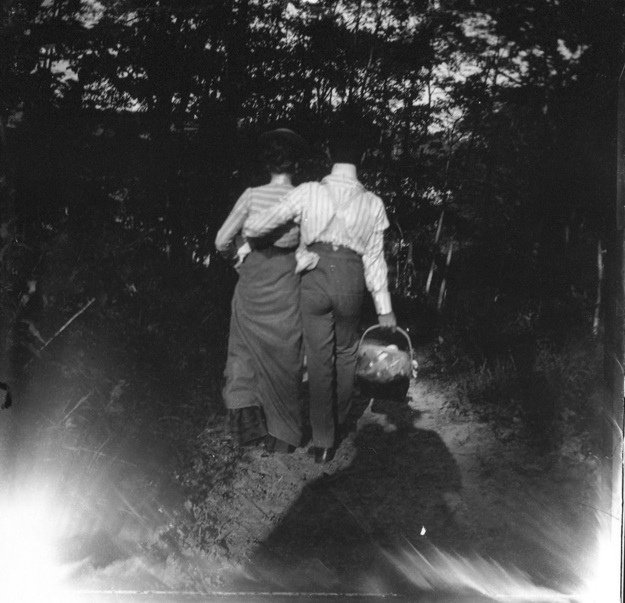 photo of Unidentified Couple with a Picnic Basket