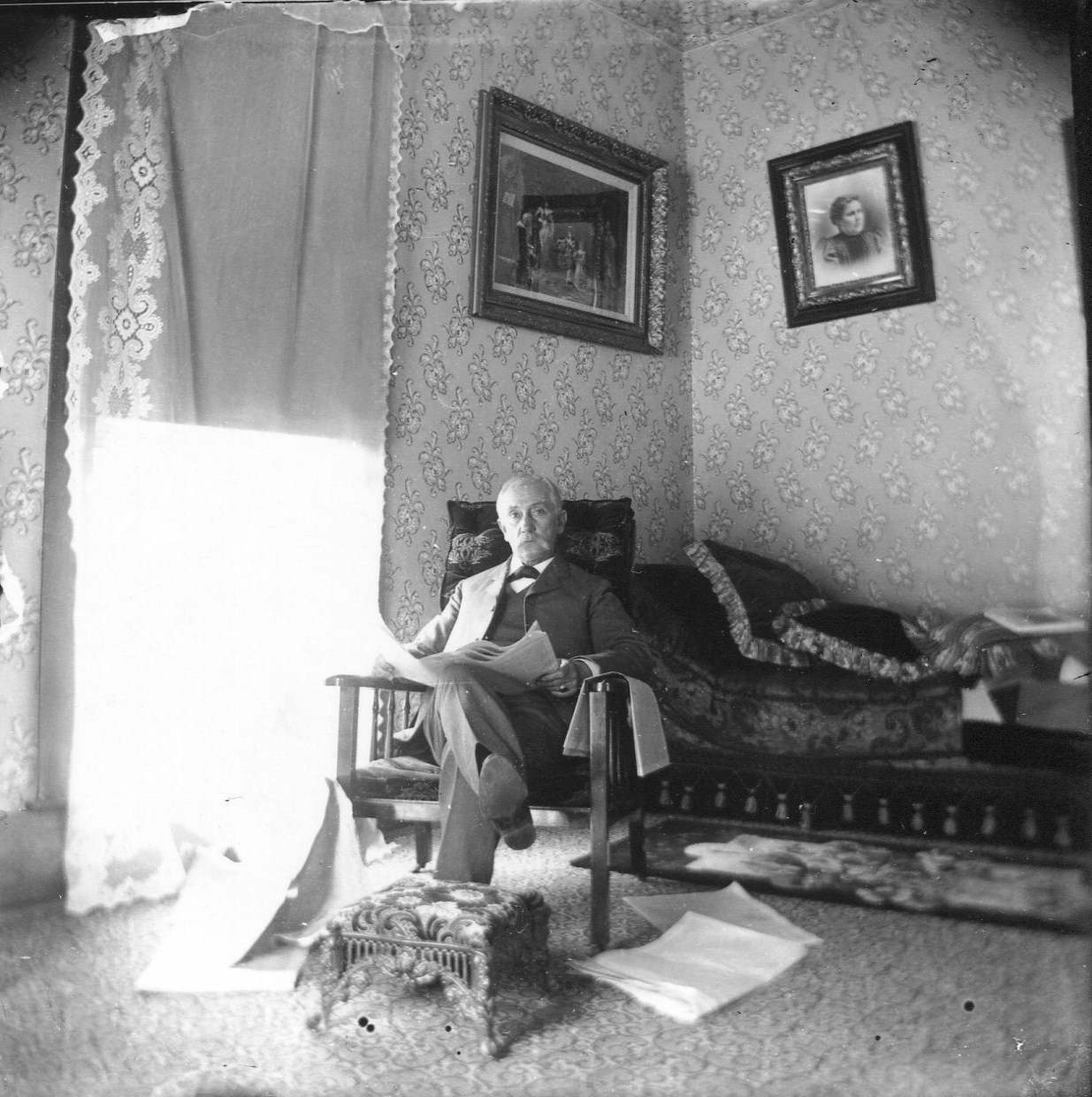 photo of Unidentified Man Sitting in a Livingroom