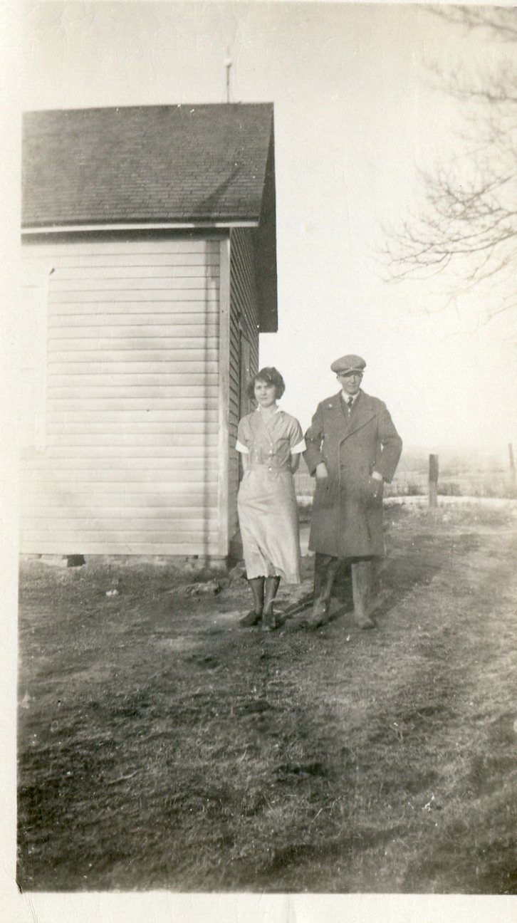 photo of Unidentified Man and Woman in Front of a House
