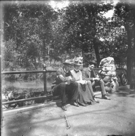 photo of Unidentified Men and Woman on a Bridge