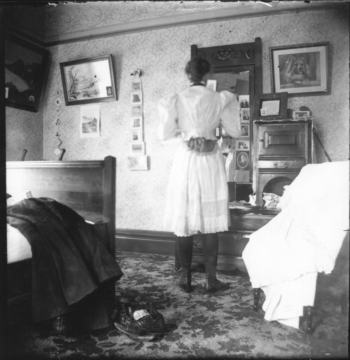 photo of Unidentified Woman Looking in a Mirror