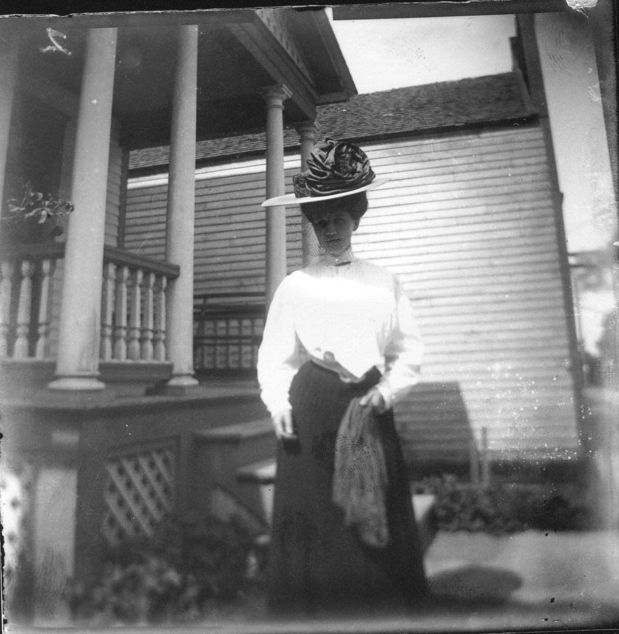photo of Unidentified Woman in Front of a House