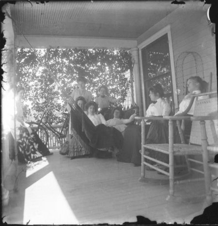 photo of Unidentified Women Sitting Outside on a Porch