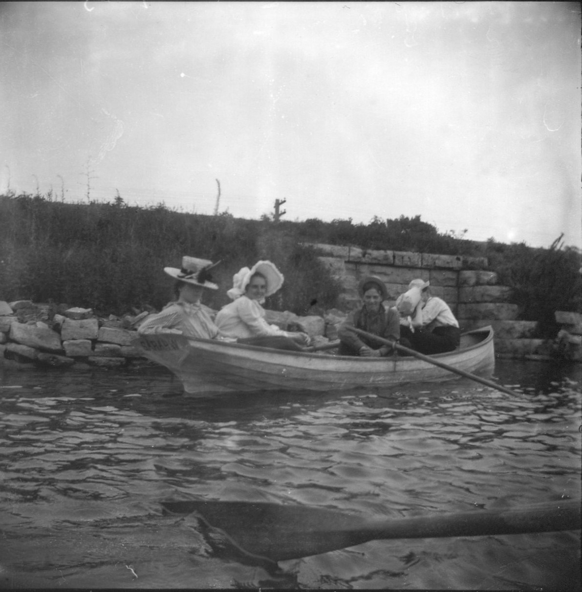photo of Unidentified Women and Man in a Rowboat