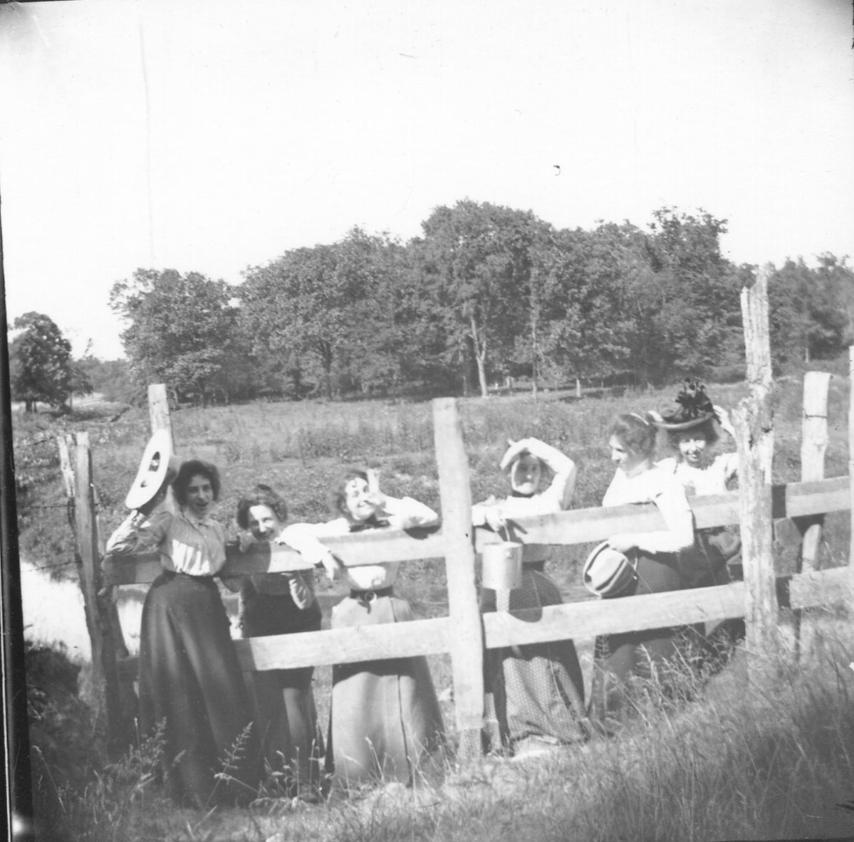 photo of Unidentified Women by a Fence