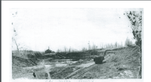 Picture of the Old Verba Quarry. It is a flattened, excavated landscape with a railroad track going around the edge.