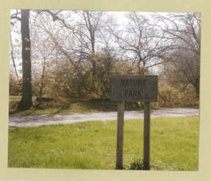 Wodden sign that reads Nature Park