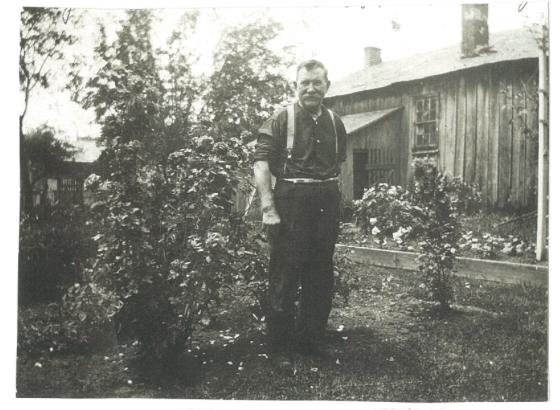Photo of Martin Shantz in front of his blacksmith shop