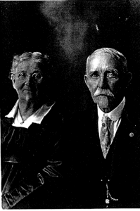 Family photo of Amos Strother and Ellen Strother in their 80s. Amos has a broad mustache and neatly combed goatee, and Ellen wears glasses