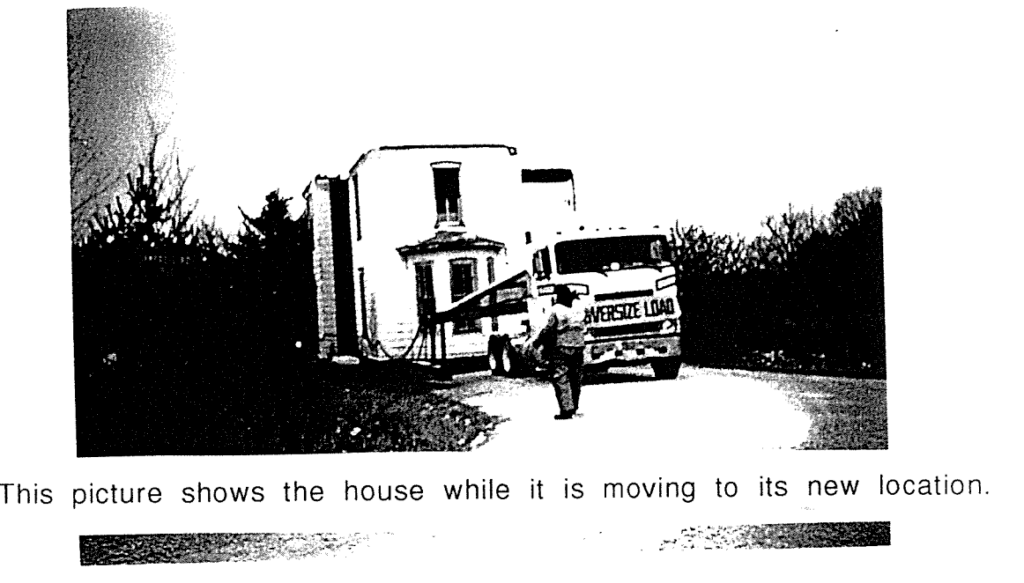 House being moved by a trailer.