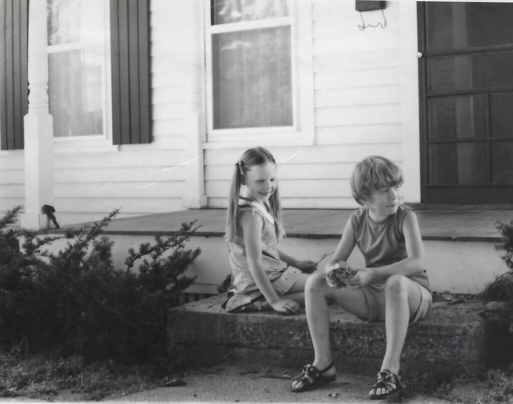 Photo of two girls playing on the front steps