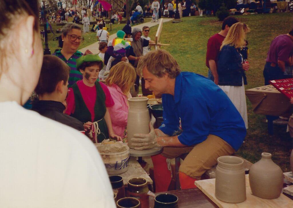 Photo of Hansen demonstrating throwing pottery on the wheel