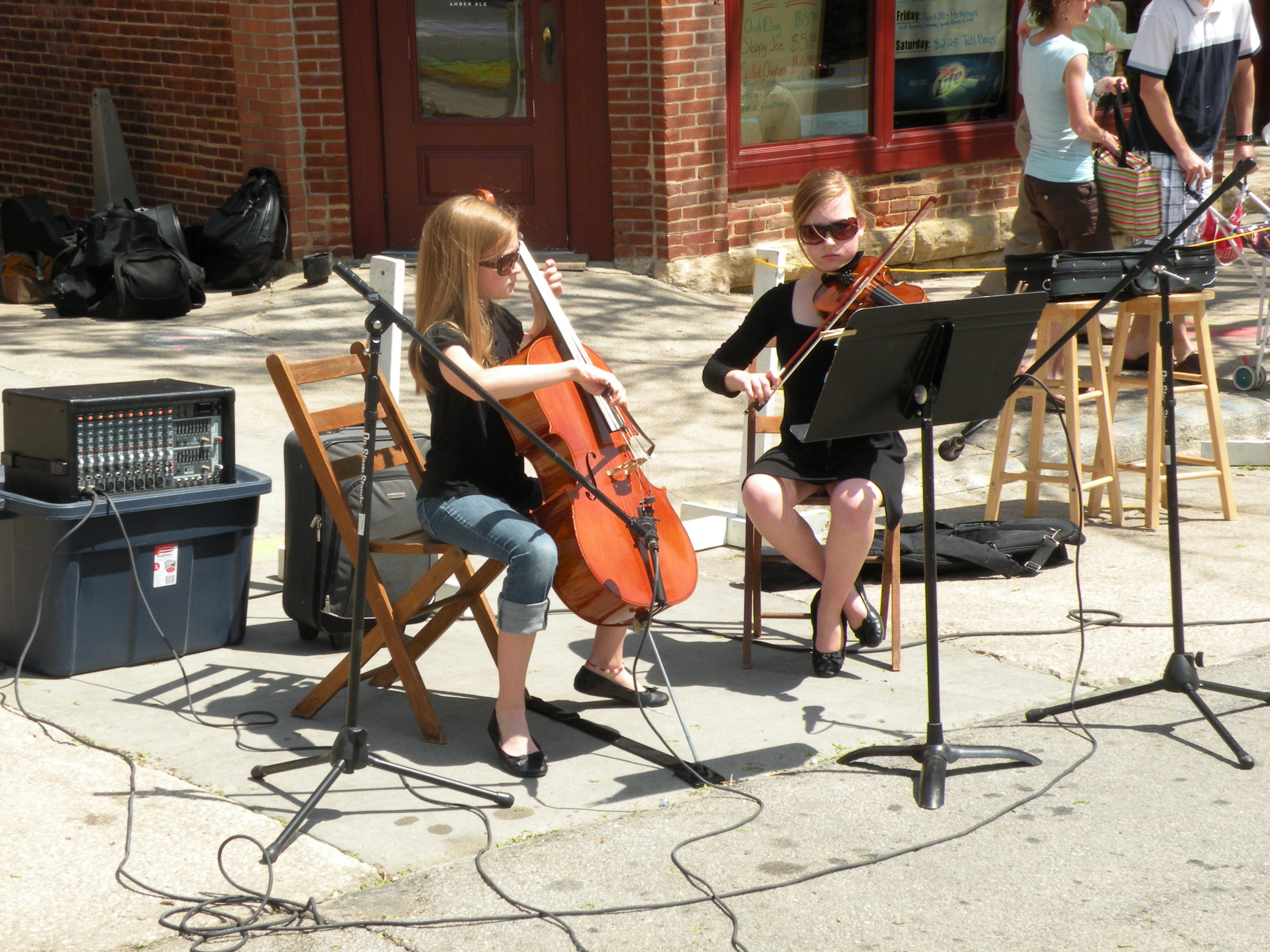 Photo of two girls playing cello and violin