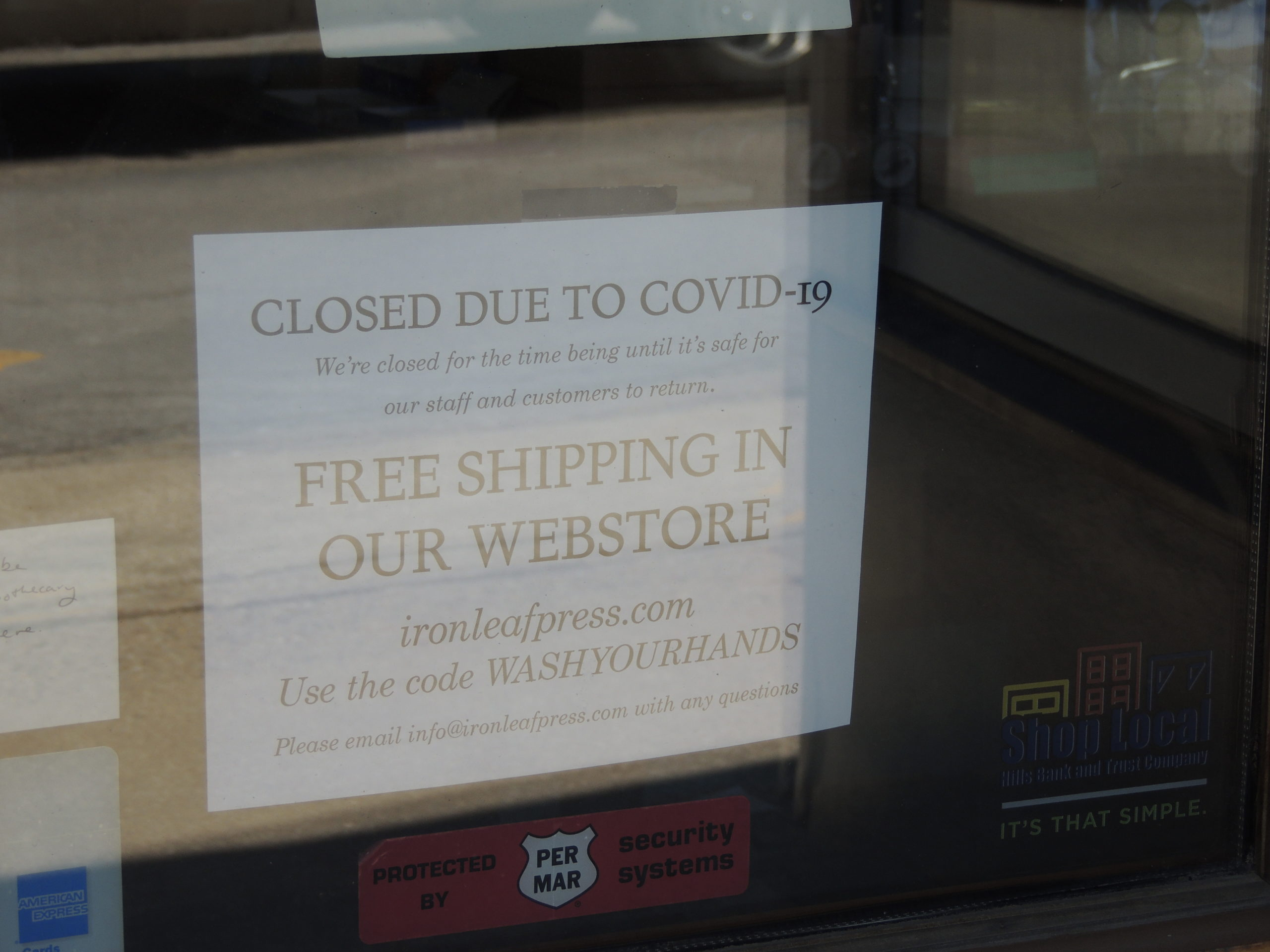 Photo of sign in Iron Leaf Press window