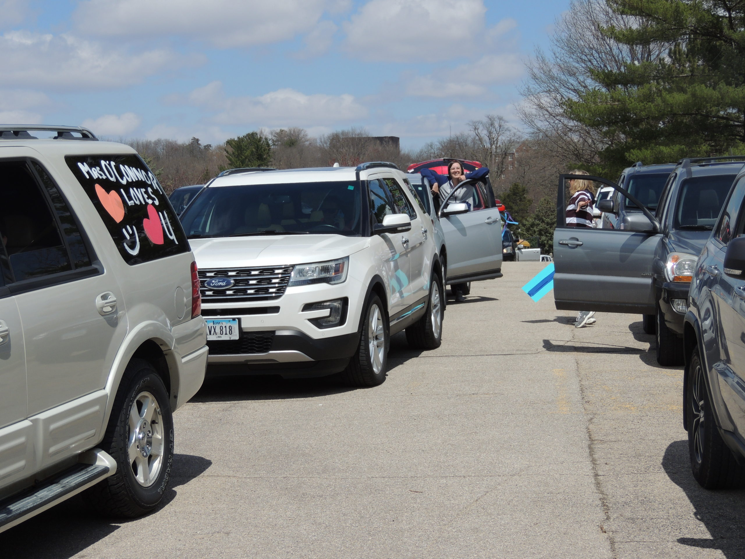 Photo of cars lined up for a parade