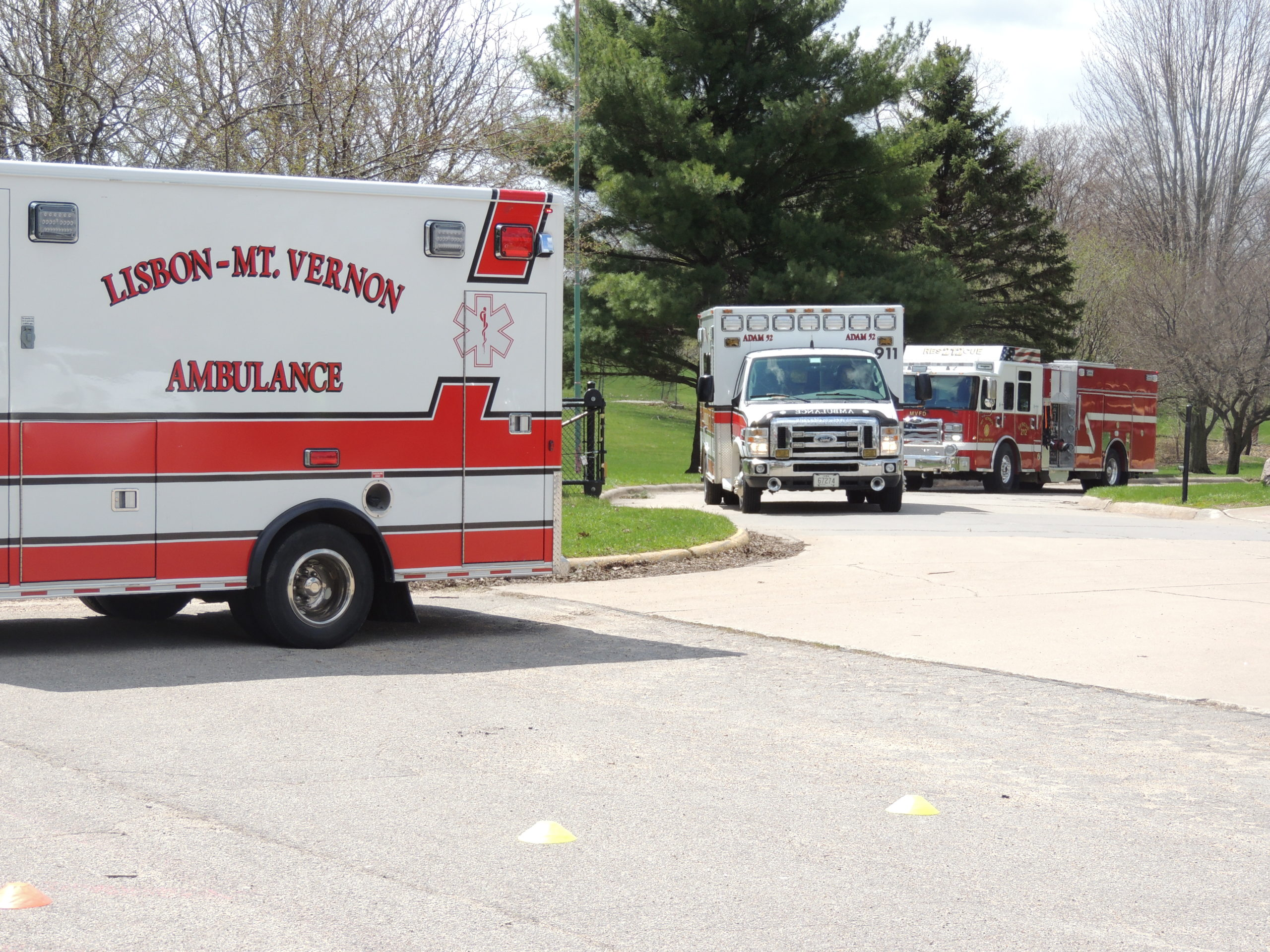 Photo of ambulances and fire truck