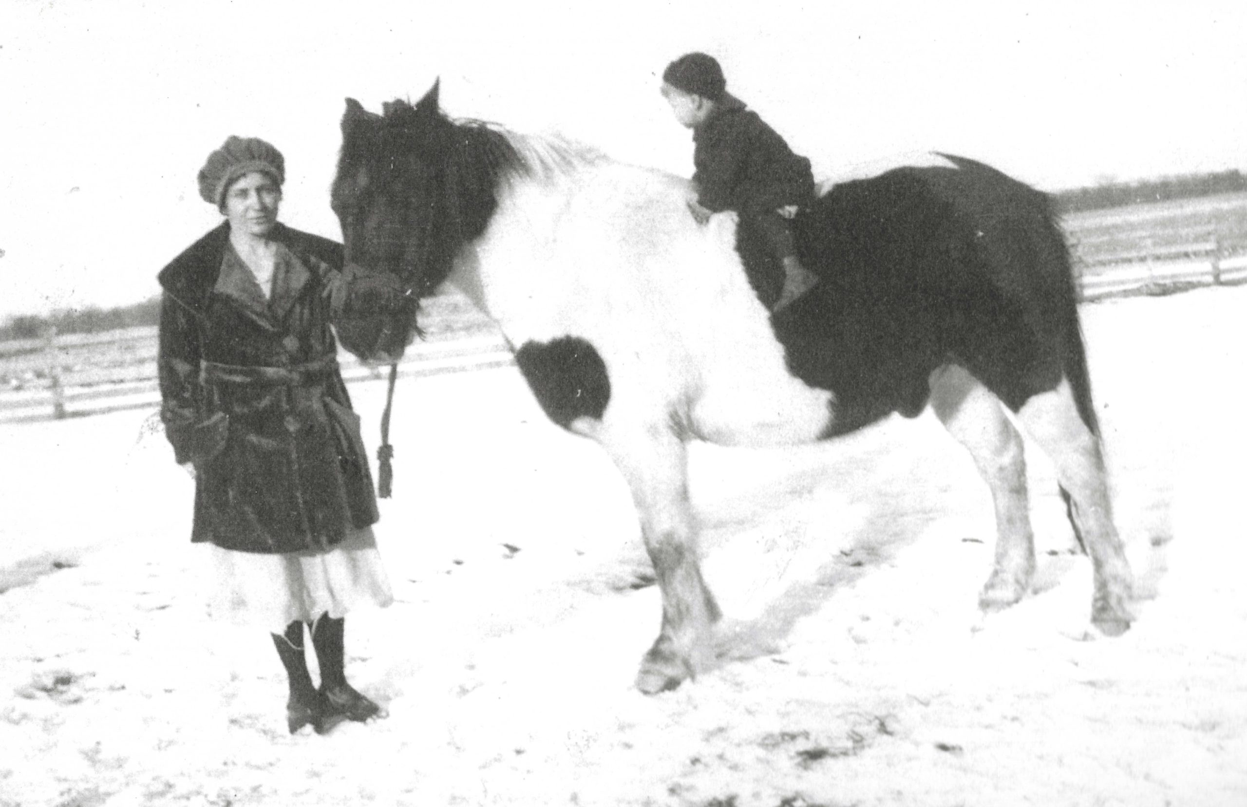 Photo of a mother leading a pony