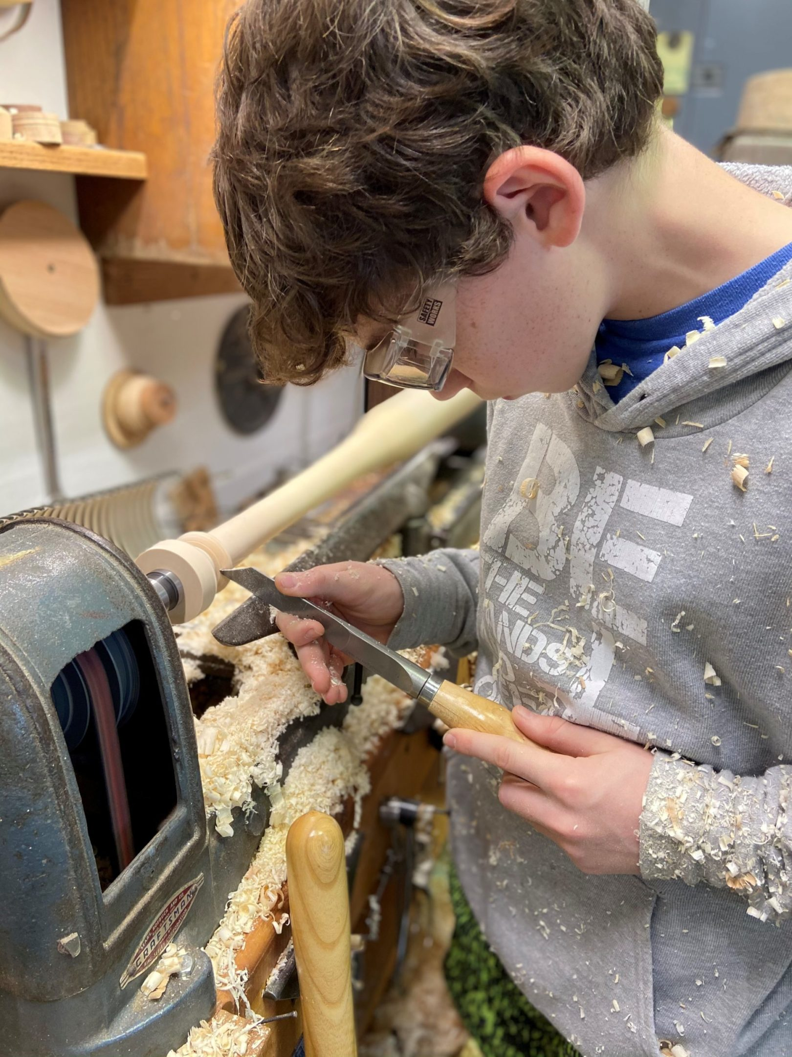 Photo of Tommy Rhomberg using his woodworking lathe